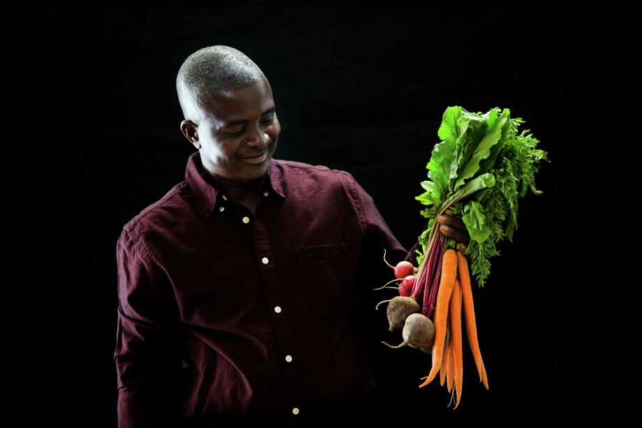 "From ""The Million: Traces of Home"": Adrien Ikaba, originally from Congo was trained in economics but became a farmer when he migrated to the United States. Photo: Marie D. De Jesus, Houston Chronicle / © 2015 Houston Chronicle"