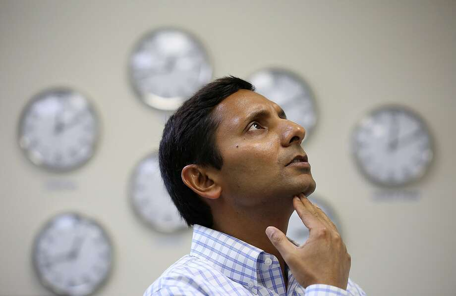 Founder and CEO Amit Kumar of Trimian helps engineers solve a complicated bug fix in the office at Menlo Park, Calif., on Thursday, October 29, 2015. Photo: Liz Hafalia, The Chronicle