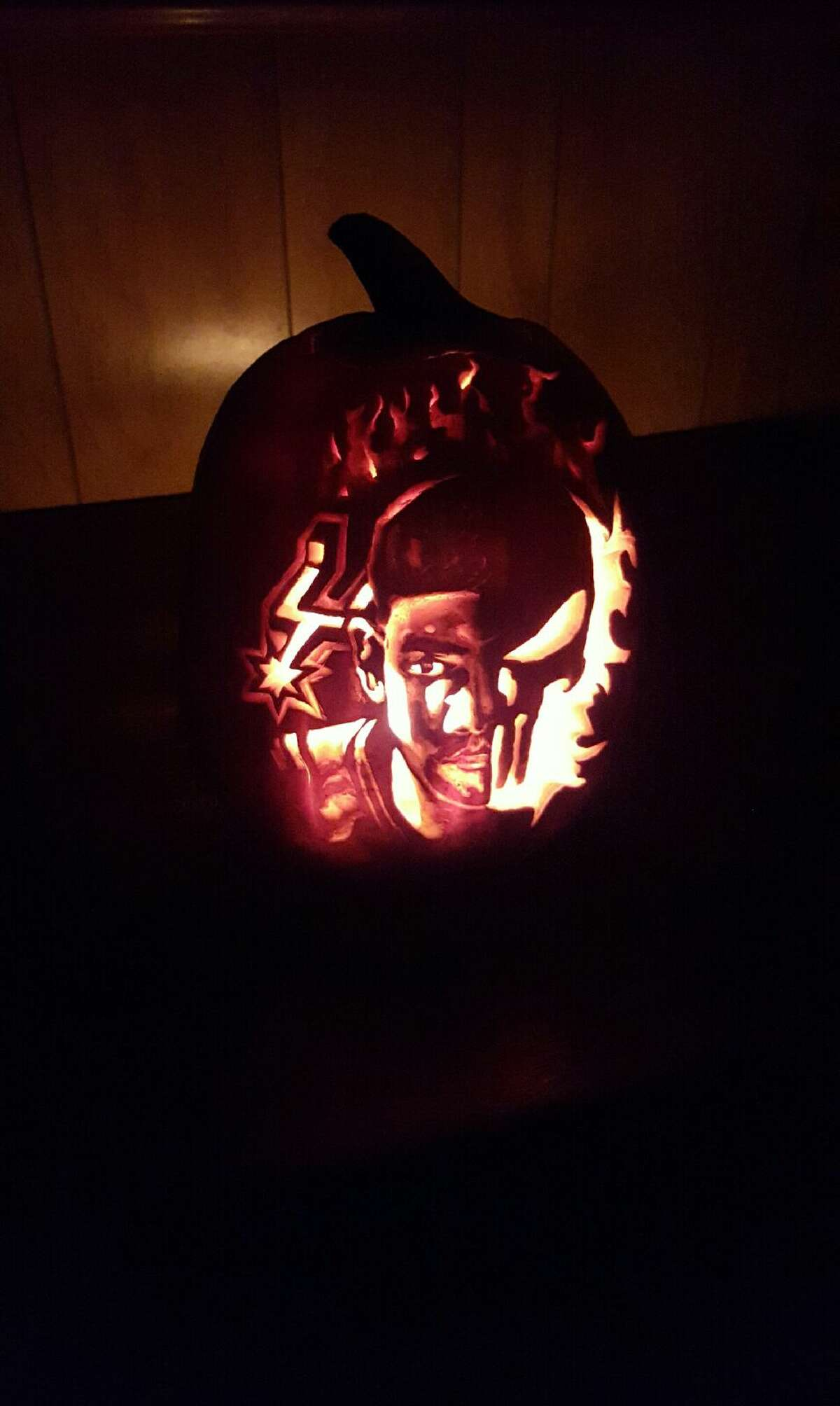 A transplanted Spurs fan said he's showing his unwavering Silver and Black pride while in Cleveland Cavaliers territory with his amazing pumpkin carving of Tim Duncan.