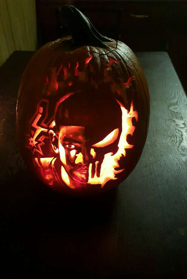 A transplanted Spurs fan said he's showing his unwavering Silver and Black pride while in Cleveland Cavaliers territory with his amazing pumpkin carving of Tim Duncan. Photo: Proved By Arthur Alaquinez