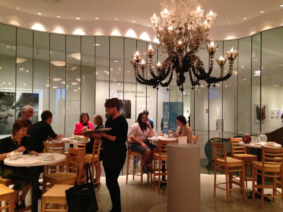"Fred Wilson's ""To Die Upon a Kiss,"" a Murano glass chandelier, hangs above the new MFAH Cafe's see-and-be-seen corner."