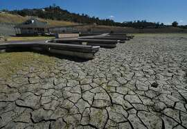 (FILES) A picture taken on September 17, 2015 shows boat docks sitting empty on dry land, as Folsom Lake reservoir near Sacramento stands at only 18 percent capacity during severe drought in California. A team of researchers led by Marshall Burke from Stanford University analyzed economic data from 166 countries over a period of 50 years, between 1960 and 2010. Beyond 13 degrees Celsius, productivity starts 'declining sharply', according to their study published on October 21, 2015. AFP PHOTO / MARK RALSTONMARK RALSTON/AFP/Getty Images