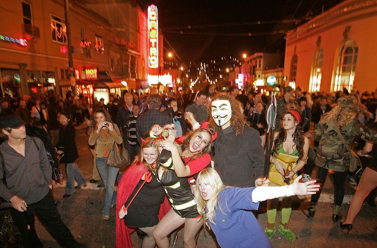 A group of party goers having fun on Castro St. Halloween in the Castro of San Francisco in 2006.