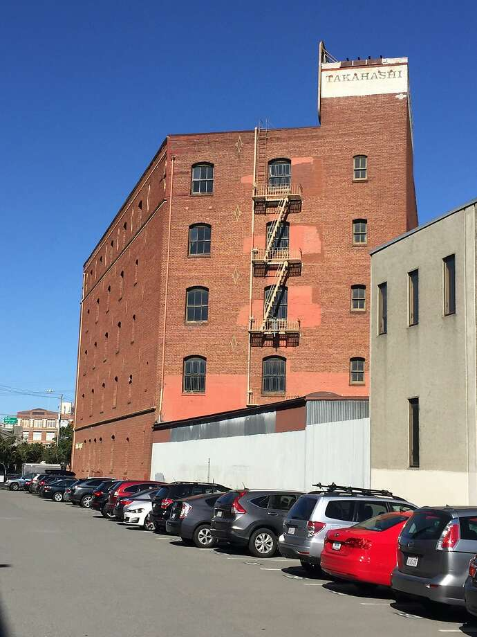 Built for a maker of threshing machines, longtime home to the  Takahashi Trading Corp., the brick building at 200 Rhode Island St. rises behind 16th Street at the foot of Potrero Hill. Photo: John King, The Chronicle