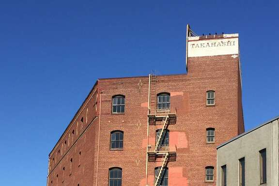 Built for a maker of threshing machines, longtime home to the  Takahashi Trading Corp., the brick building at 200 Rhode Island St. rises behind 16th Street at the foot of Potrero Hill.