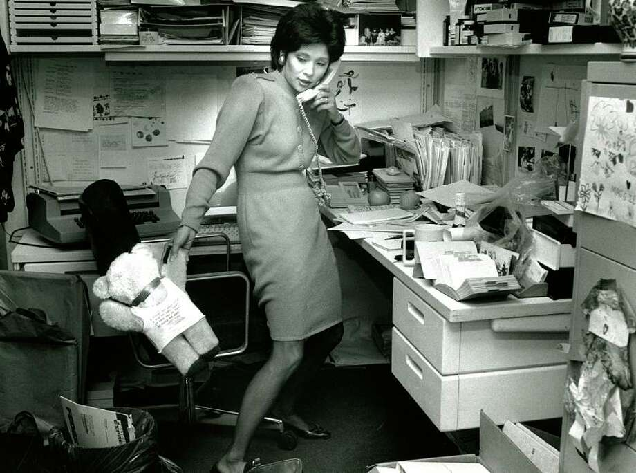 In this 1990 photo, Wendy Tokuda returns calls at KPIX. According to the original caption, the teddy bear is from a young fan. Photo: Liz Hafalia, The Chronicle