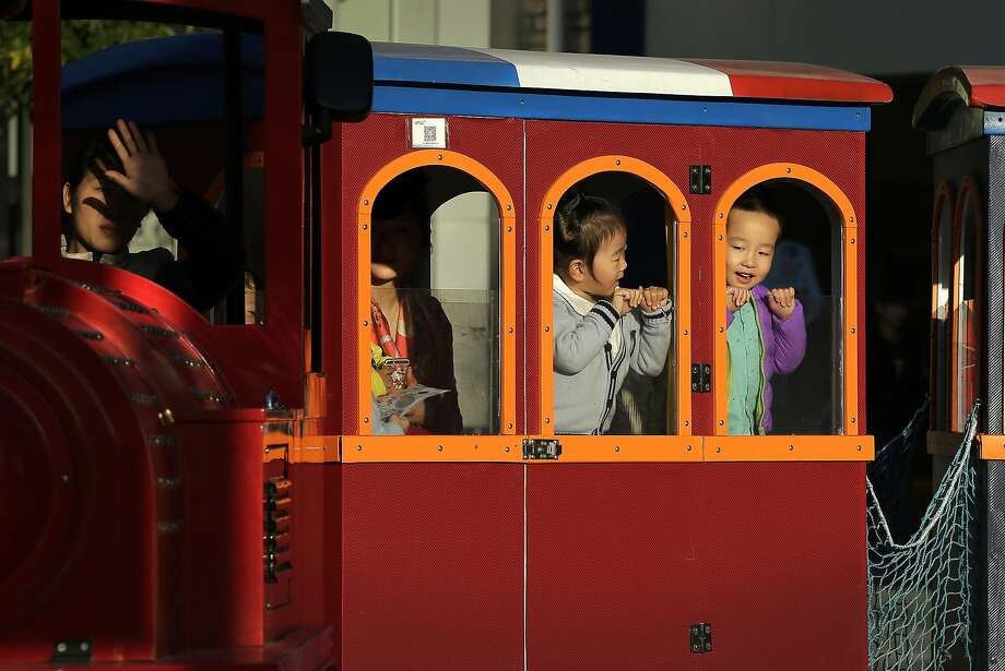China's decision to abolish its one-child policy is a boon to couples and to sellers of goods from formula to diapers to toys. Photo: Andy Wong, Associated Press