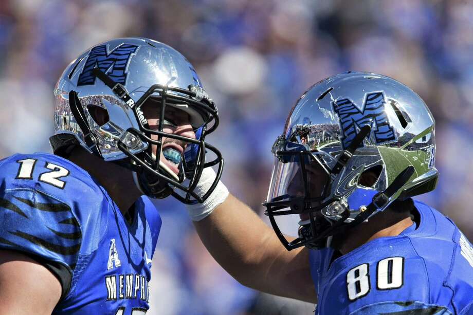 Daniel Montiel (80) celebrates with Paxton Lynch of the Memphis Tigers after a touchdown against the Ole Miss Rebels at Liberty Bowl Memorial Stadium on Oct. 17, 2015 in Memphis, Tenn. Photo: Wesley Hitt /Getty Images / 2015 Getty Images
