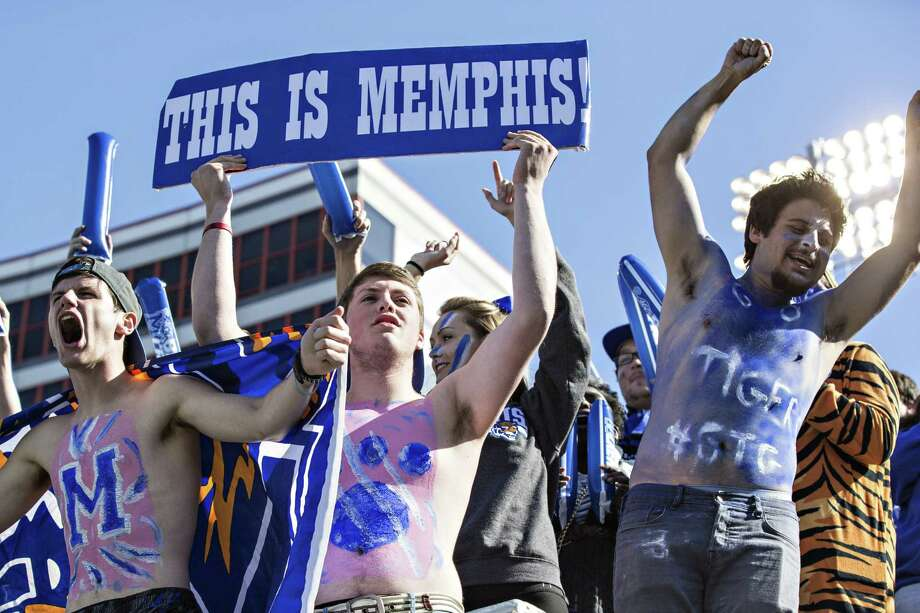 Student section of the Memphis Tigers celebrates after a touchdown during a game against the Ole Miss Rebels at Liberty Bowl Memorial Stadium on Oct. 17, 2015 in Memphis, Tenn. Photo: Wesley Hitt /Getty Images / 2015 Getty Images