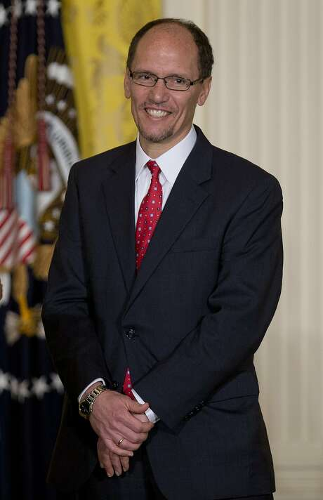 """Thomas """"Tom"""" Perez, assistant attorney general at the U.S. Department of Justice and nominee to become U.S. secretary of labor, listens as U.S. President Barack Obama, not pictured, makes the nomination announcement in the East Room of the White House in Washington, D.C., U.S., on Monday, March 18, 2013. Perez would replace Hilda Solis, ensuring that the Labor Department is led again by a Hispanic, helping the president maintaining diversity in his second term cabinet. Solis resigned in January. Photographer: Andrew Harrer/Bloomberg *** Local Caption *** Tom Perez Photo: Andrew Harrer, Bloomberg"""