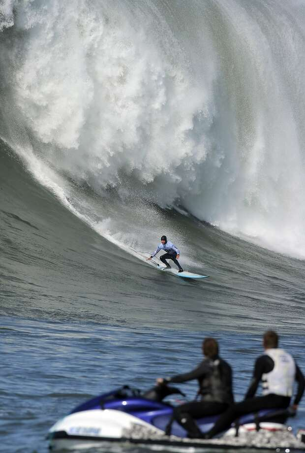 """Grant """"Twiggy"""" Baker finishes off a nice ride during the 2010 Mavericks contest, held in the largest surf yet witnessed in the event. Photo: Carlos Avila Gonzalez, The Chronicle"""