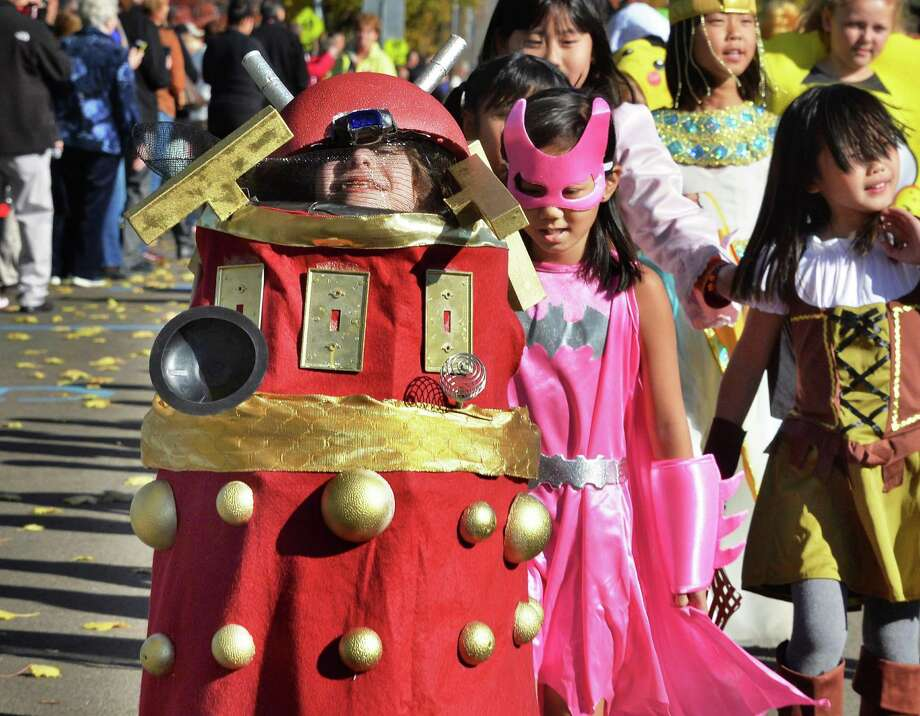 Ari Kaufman, left, peers out from her Dalek costume (from Dr. Who) in the annual Halloween Parade at Division Street Elementary School Friday Oct. 30, 2015 in Saratoga Springs, NY.  (John Carl D'Annibale / Times Union) Photo: John Carl D'Annibale / 00034022A