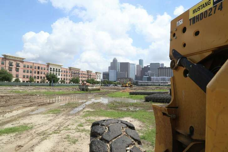 A tractor sits on the construction site of Camden Property Trust's new park in Midtown near the Camden Travis Street Apartments.    Thursday, May 28, 2015, in Houston. ( Dylan Aguilar / Houston Chronicle )