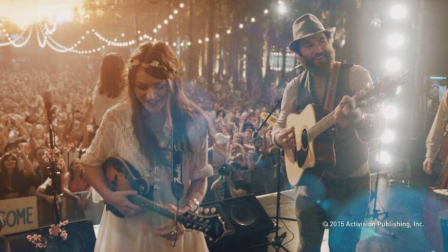 A Screenshot from Guitar Hero Live while playing in Live mode which puts the players in front of a full-motion video audience and band that seamlessly and dynamically responses to your playing abilities. Photo: Activision