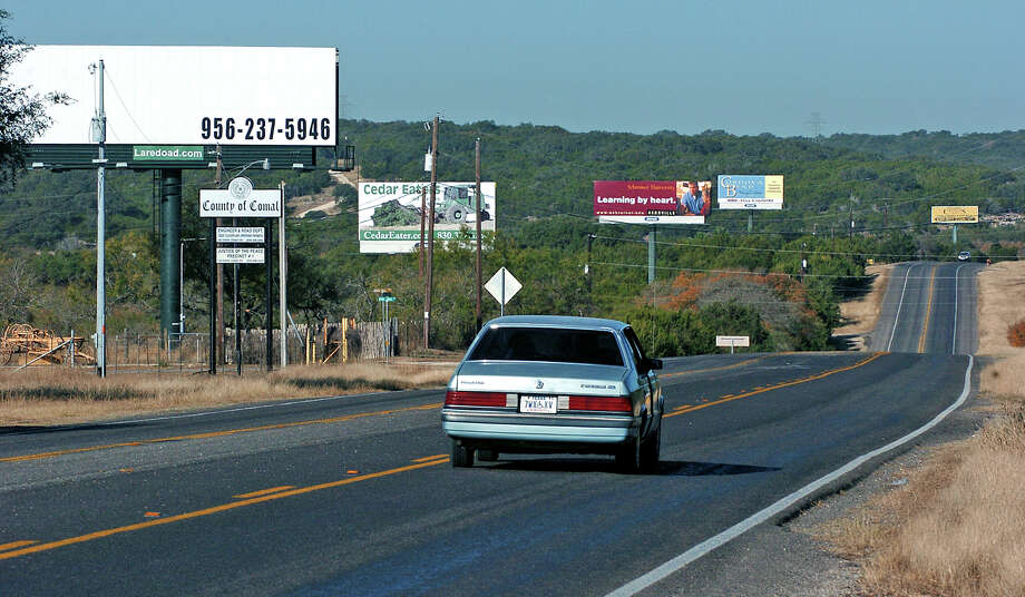 A reader says billboards degrade the natural beauty along our roadsides in Texas. Photo: TOM REEL /SAN ANTONIO EXPRESS-NEWS / SAN ANTONIO EXPRESS-NEWS