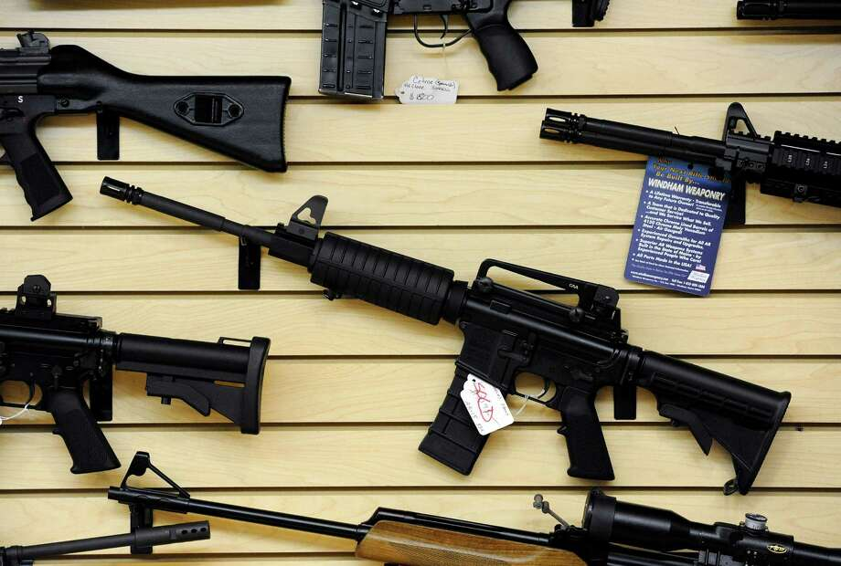 Why is the public allowed to have military style weapons that kill many quickly? Here, an AR-15, of the kind Mark Anthony Gonzalez used to kill Bexar County Sheriff Sgt. Kenneth Vann, is displayed in Maryland. Photo: STEVE RUARK /New York Times / NYTNS