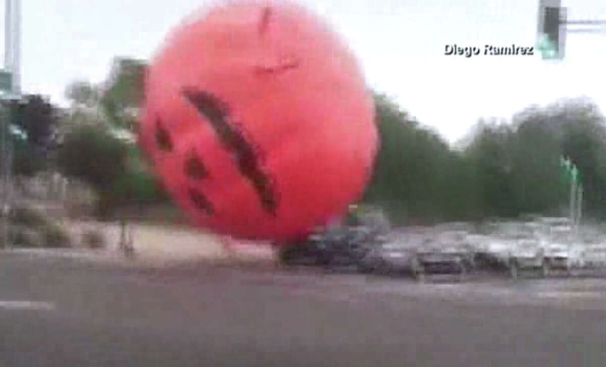 A giant inflatable pumpkin broke loose and terrorized autos in Peoria, Ariz.