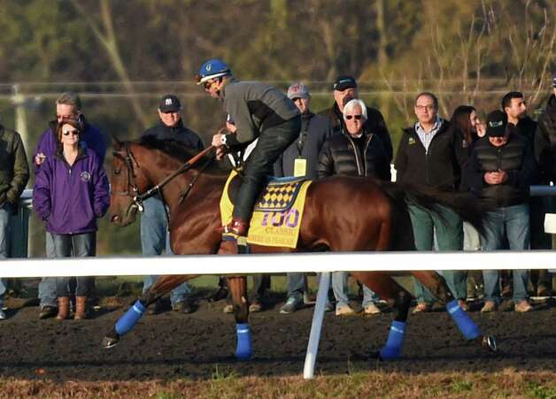 Breeders' Cup Classic entrant and Triple Crown winner American Pharoah goes out for exercise on the training track of Keeneland Race Course under the watchful eye of trainer Bob Baffert, second from right and owner Ahmed Zayat, right Thursday morning Oct. 29, 2015 in Lexington, KY.  (Skip Dickstein/Times Union) Photo: SKIP DICKSTEIN