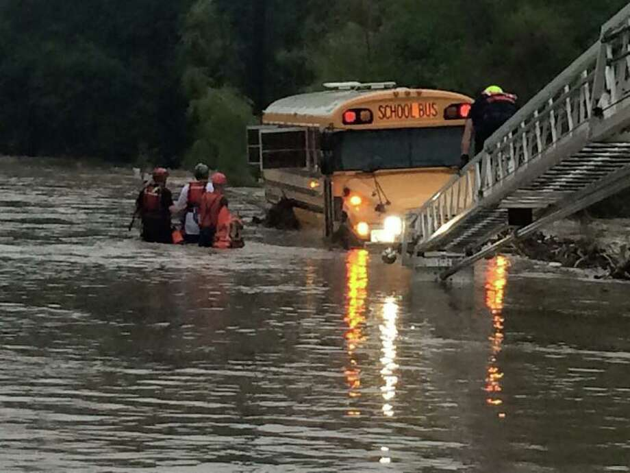 Bexar County Sheriff's Department rescued a total of four special needs students and two adults from a flooded bus on Scenic Loop. Photo: Courtesy
