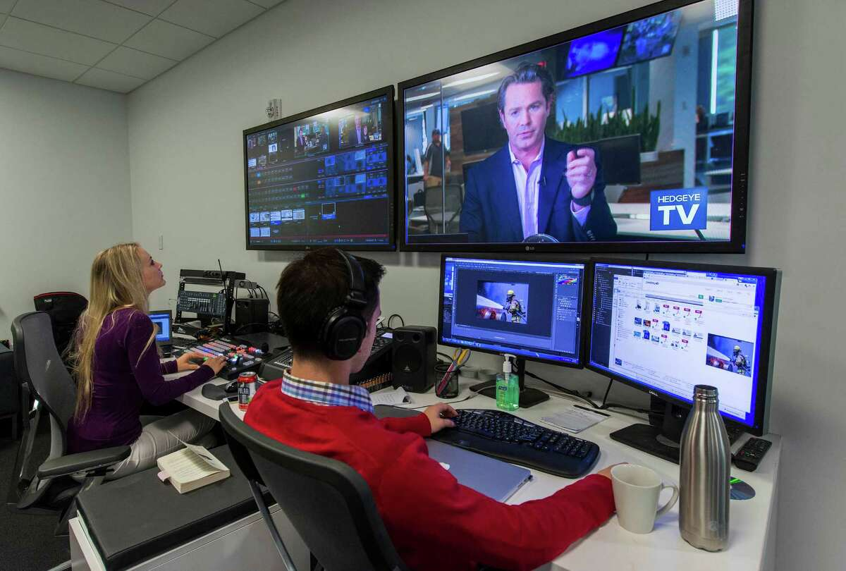Director Josefine Allain and producer Matt Petterson work in the control room during a broadcast at Hedgeye Risk, Stamford, Conn., on October 8, 2015.