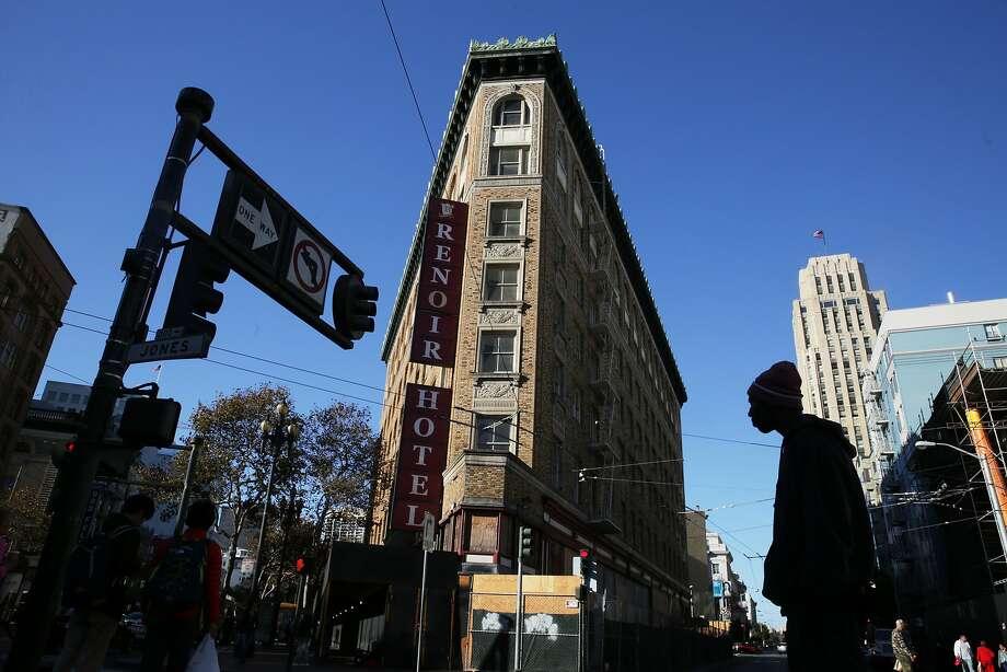 Pedestrians cross the street next to the Renoir Hotel on Thursday, October 29,  2015 in San Francisco, Calif. Photo: Lea Suzuki, The Chronicle