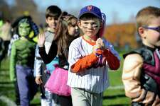 George Anastasakis, 6, a huge New York Mets fan, marches in the Halloween parade as Mets captain David Wright at Rockwell Elementary School in Bethel on Friday, Oct. 30, 2015. The Mets faced the Kansas City Royals in Game 4 of the World Series at Citi Field on Saturday night.