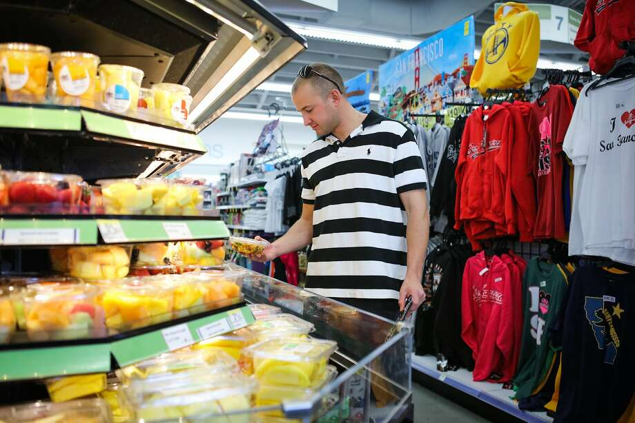 Justin McKenna, a US Coast Guard, grabs a fresh fruit cup at Walgreens Pharmacy in San Francisco, California on Friday, October 30, 2015. Photo: Gabrielle Lurie, Special To The Chronicle
