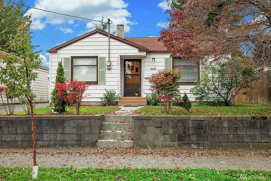 The first home, 9219 15th Ave. S.W., is listed for $240,000. The three bedroom, one bathroom home sits on a large lot with a big detached garage. It is also zoned for potential commercial development opportunities. 