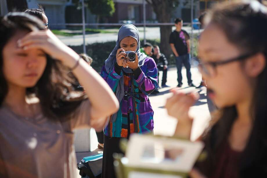 Mai Sinada, a student at Wallenberg High School, takes photos during lunchtime in San Francisco, California on Friday, October 30, 2015. Photo: Gabrielle Lurie, Special To The Chronicle