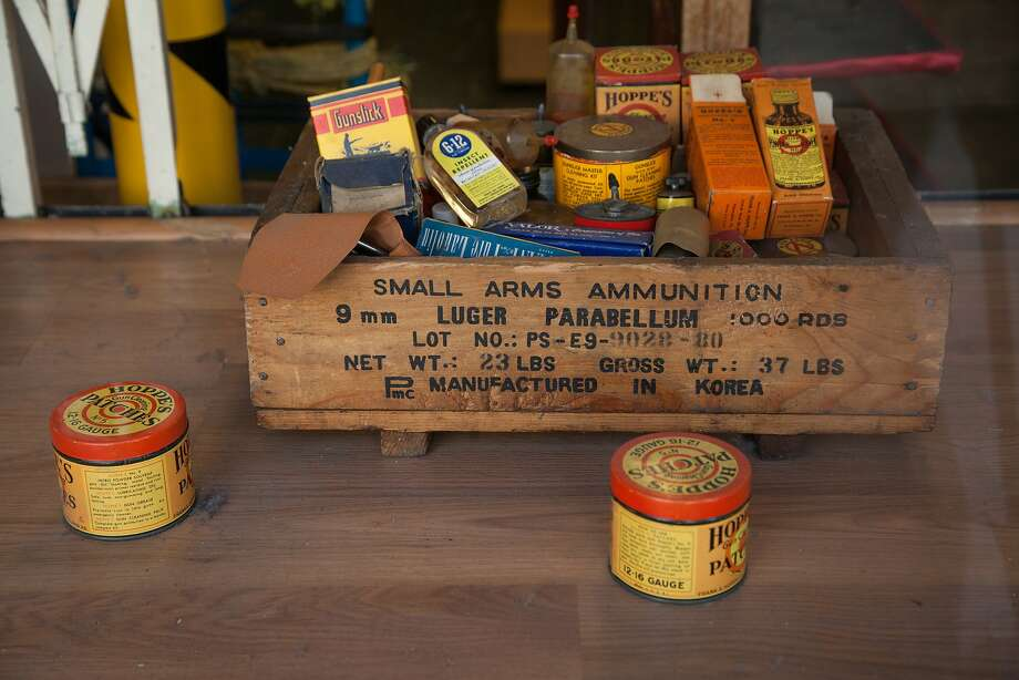 Empty antique ammunition boxes are seen at the display window at High Bridge Arms on Oct. 30 in San Francisco. Photo: Santiago Mejia, Special To The Chronicle