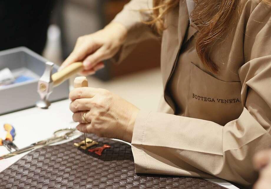 Artisans from Bottega Veneta's Italian atelier will be in San Francisco Nov. 11 and 12 offering monogramming on select bags. Photo: Bottega Veneta