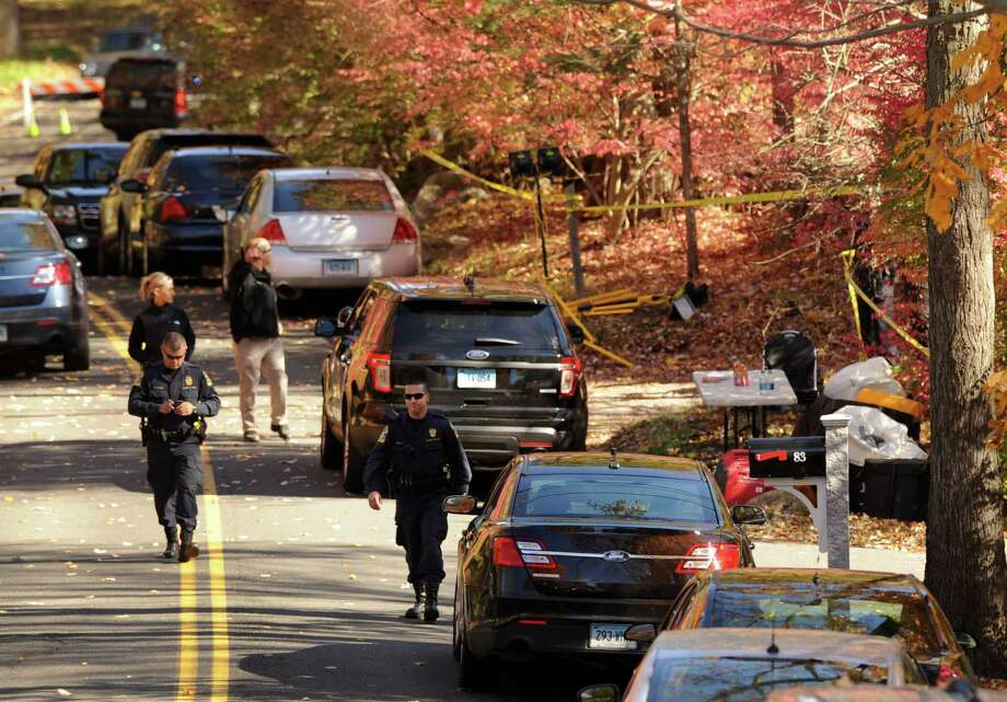 State Police approach a home at 89 Norfield Road in Weston on Friday. A search of the property uncovered two bodies that sources said were believed to be those of Jeffrey and Jeanette Navin. Photo: Cathy Zuraw / Hearst Connecticut Media / Connecticut Post
