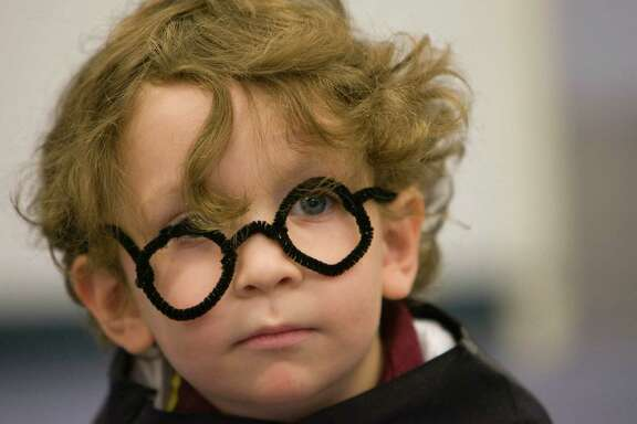 Zachary Ibarra, 3, of Houston, dressed as the character Harry Potter as the Katherine Tyra Branch Harris County Public Library celebrated Harry Potter's birthday, Thursday, July 30, 2009, in Houston.  The celebration included making Harry Potter glasses, making crafts, a costume contest, games and a birthday cake. The character Harry Potter shares his birthday, which is officially tomorrow, with author of the Harry Potter book series, J.K Rowling. ( Johnny Hanson / Chronicle )