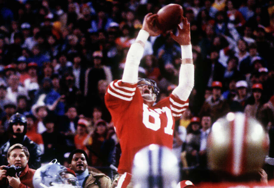 Dwight Clark #87 of the San Francisco 49ers makes a touchdown catch on a pass from Joe Montana to score the game winning touchdown against the Dallas Cowboys to win the NFC Championship at Candlestick Park on January 10, 1982 in San Francisco, California. (Photo by Rob Lindquist/Getty Images) / 1982 Rob Lindquist