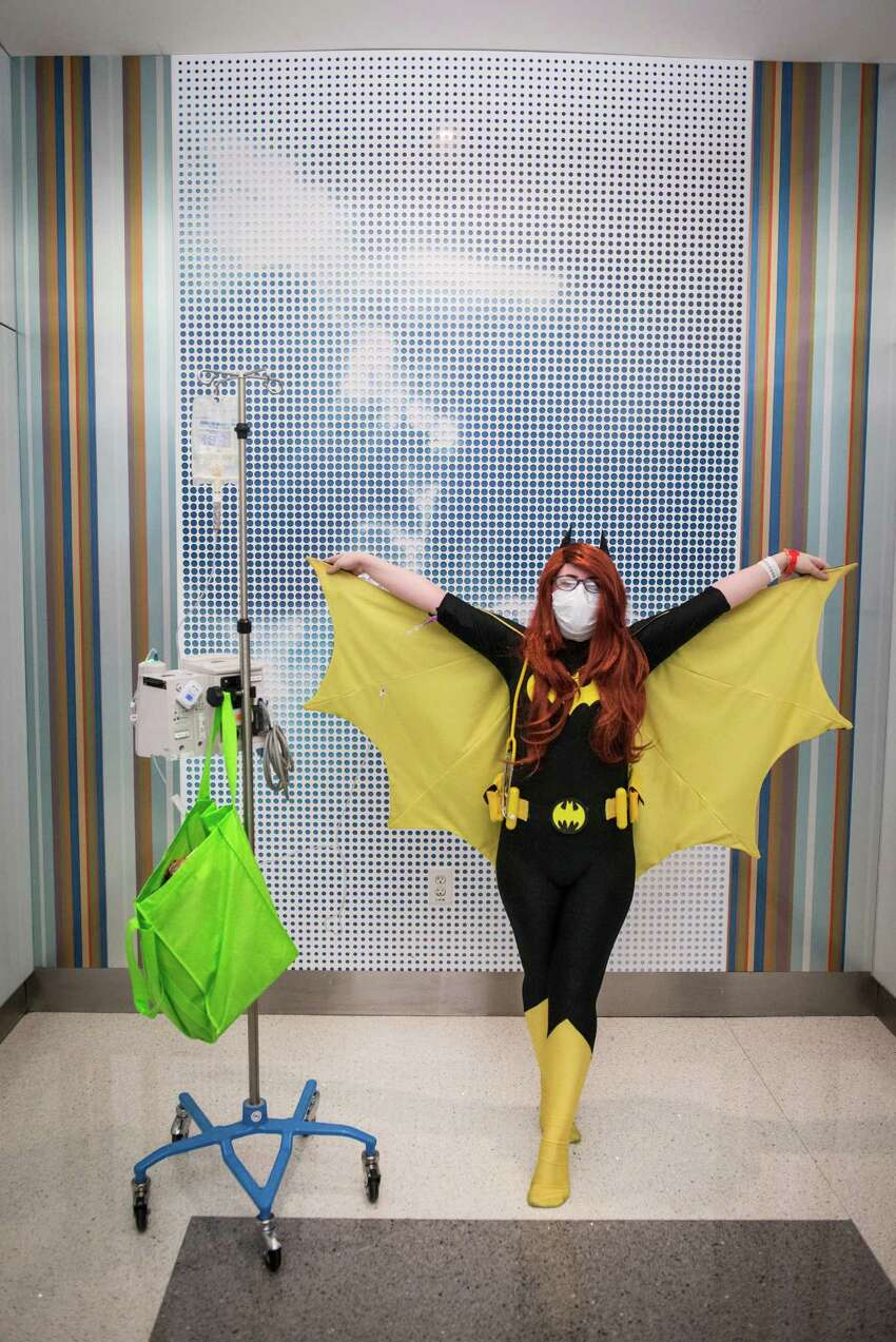 Kendra Manning, who suffers from cystic fibrosis, dressed as bat girl for University Hospital's annual Halloween Pediatric Parade in San Antonio on Friday, October 30, 2015. University Hospital's annual Pediatric Parade includes current and former pediatric patients dressed in costumes and trick-or-treating through the hospital's Sky Tower.