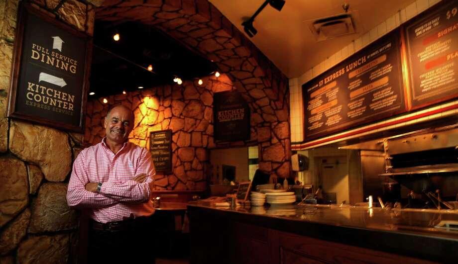 John Gilbert, CEO and co-owner of Romano's Macaroni Grill photographed on Thursday, June 25, 2015, in Houston.  ( Karen Warren / Houston Chronicle ) Photo: Karen Warren, Staff / © 2015 Houston Chronicle