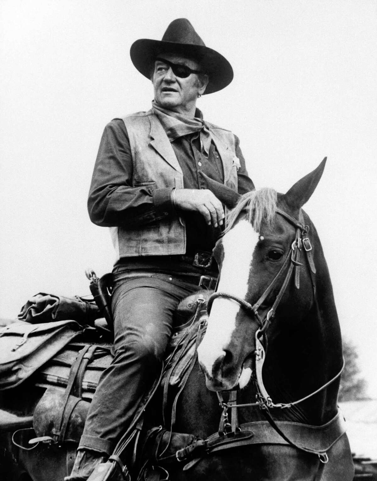 """John Wayne The most popular cowboy ever did an introduction before the first """"Gunsmoke"""" show."""