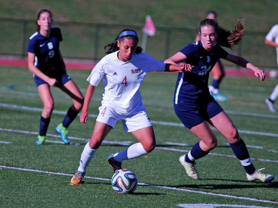 St. Joseph's Jessica Mazo, left, controls the ball while Staples' Erin Lynch applies pressure during the FCIAC girls soccer quarterfinals on Friday in Trumbull. Photo: Ryan Lacey / Hearst Connecticut Media / Westport News Contributed