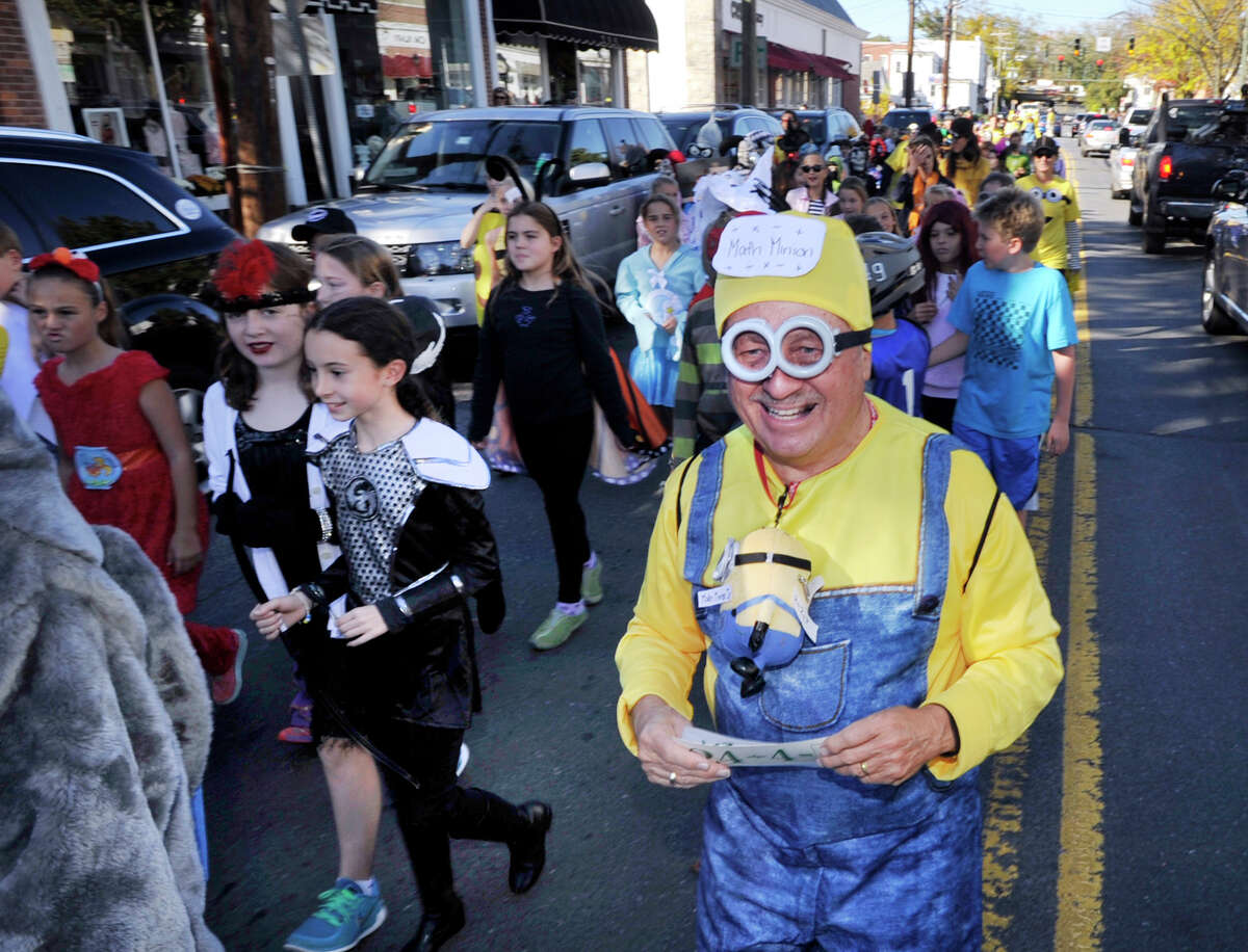 Old Greenwich School substitute teacher Larry Walker was a Minion during the annual Halloween parade at the school and on Sound Beach Avenue in Old Greenwich, Conn., Friday afternoon, Oct. 30, 2015.