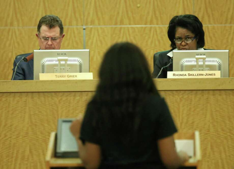 HISD Superintendent Terry Grier and board member Paula Harris listen as a Hope Academy supporter speaks during an HISD School Board meeting Thursday, June 18, 2015, in Houston. ( Jon Shapley / Houston Chronicle ) Photo: Jon Shapley, Staff / © 2015 Houston Chronicle