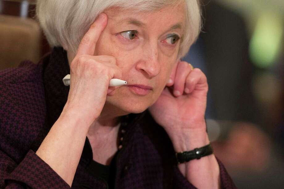 Federal Reserve Chair Janet Yellen listens to a presentation during a meeting of the Board of Governors of the Federal Reserve, Friday, Oct. 30, 2015, in Washington. The meeting was to discuss a proposed rule establishing total loss-absorbing capacity and long-term debt requirements for global systemically important banking organizations, as well as a final rule on margin and capital requirements for uncleared swaps of prudentially regulated swap entities. (AP Photo/Evan Vucci) Photo: Evan Vucci, STF / AP