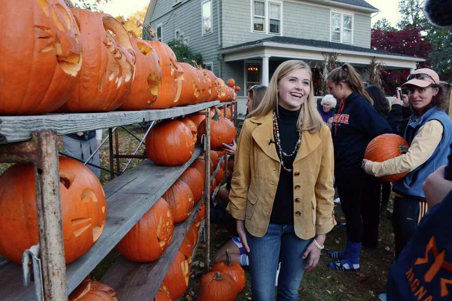 Mackenzie Page, 17, from Newtown hosted a fundraiser to bring awareness for Hole in the Wall Gang Camp for kids  facing medical challenges. The charity was founded by the late actor Paul Newman. The fundraiser allowed people to carve a pumpkin and leave it at Pages home in Newtown for $5. per pumpkin. The event was held on Friday, October 30,2015. Photo: Lisa Weir / For The Newstimes / The News-Times Freelance