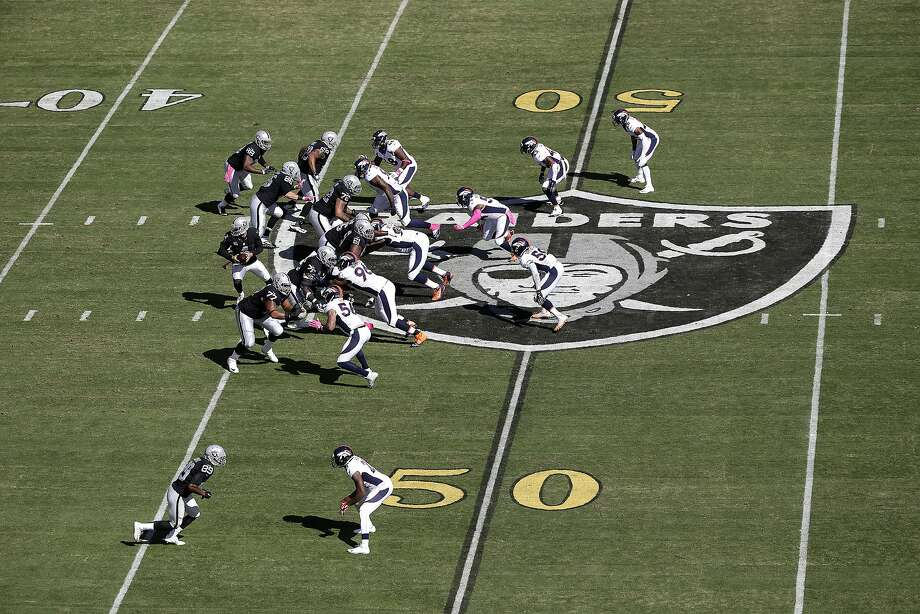 Gold 50-yard line markers are shown at the Coliseum during the game between the Oakland Raiders and the Denver Broncos on Sunday, Oct. 11, 2015. (AP Photo/Marcio Jose Sanchez) Photo: Marcio Jose Sanchez, Associated Press
