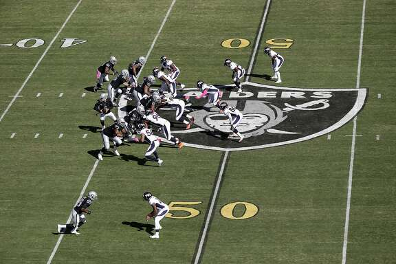 Gold 50-yard line markers are shown at O.co Coliseum during the first half of an NFL football game between the Oakland Raiders and the Denver Broncos in Oakland, Calif., Sunday, Oct. 11, 2015. (AP Photo/Marcio Jose Sanchez)