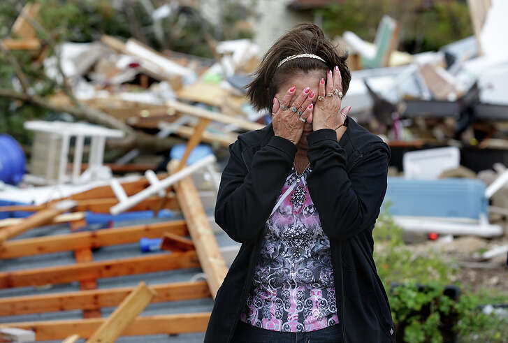 Mary Ybarra-Garcia is overcome with emotions after seeing her distroyed home on Huber Rd. in Geronimo, TX. A tornado ripped through the small farming community on Friday, October 30, 2015, just north of Seguin mangling numerous homes.