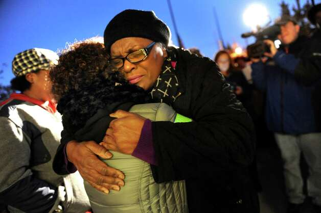 "Celinda Okwuosa, aunt of Donald ""Dontay"" Ivy, embraces a supporter during a rally on Friday, Oct. 30, 2015, at the Albany Police Department Headquarters in Albany, N.Y. Social justice advocates and the community protested a grand jury's decision not to charge police who confronted and struggled with Ivy on the night he died. (Cindy Schultz / Times Union) Photo: Cindy Schultz / 00033991A"