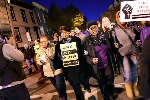 "Common Council President Carolyn McLaughlin, center, walks with Celinda Okwuosa, aunt of Donald ""Dontay"" Ivy, second from right, during a rally on Friday, Oct. 30, 2015, in Albany, N.Y. Social justice advocates and the community protested a grand jury's decision not to charge police who confronted and struggled with Ivy on the night he died. (Cindy Schultz / Times Union) Photo: Cindy Schultz / 00033991A"