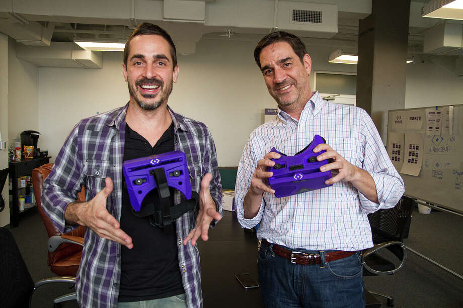 Merge VR founder and CEO Franklin Lyons (left) and co-founder Andrew Trickett show off Merge VR   headsets Friday. Photo: Alma E. Hernandez /For The San Antonio Express-News