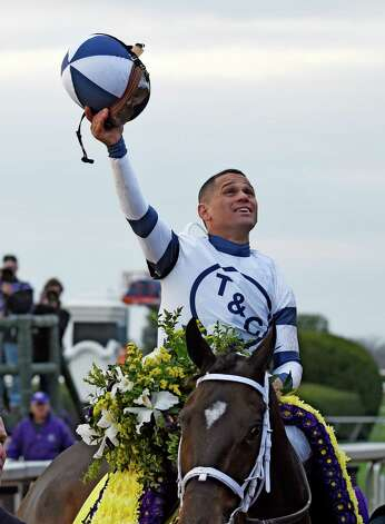 Jockey Javier Castellano holds his helmut aloof after guiding Stopchargingmaria to the win in the Breeders' Cup Distaff Friday Oct. 30, 2015 at Keeneland Race Track in Lexington, KY  (Skip Dickstein/Times Union) Photo: SKIP DICKSTEIN