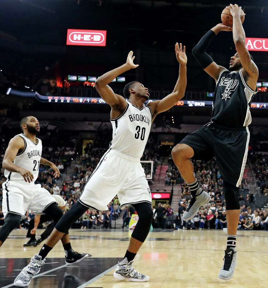San Antonio Spurs' LaMarcus Aldridge shoots over Brooklyn Nets' Thaddeus Young  as Wayne Ellington looks on during first half action Friday Oct. 30, 2015 at the AT&T Center. Photo: Edward A. Ornelas, San Antonio Express-News / © 2015 San Antonio Express-News